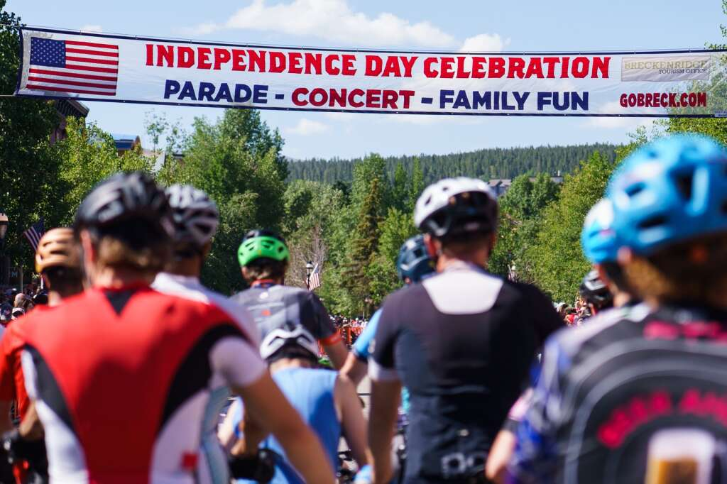 Racers prepare to depart the start line at the heart of downtown Breckenridge for the Firecracker 50 mountain bike race on July 4, 2021. | Photo by John Hanson