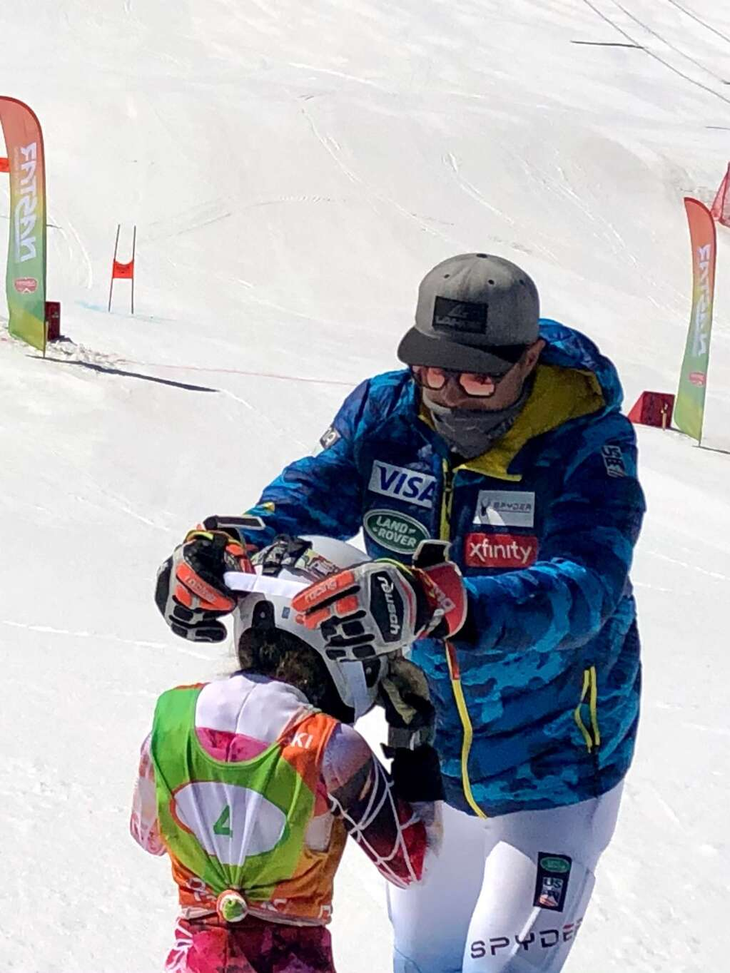 Luke Winters gives a bronze medal to NASTAR Platinum division racer Isabelle Taylor after the head-to-head finals on April 10 at Snowmass Ski Area. | Kaya Williams/The Aspen Times