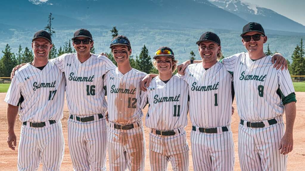 Summit seniors Foster Krueger (third from left) and Zach Misch (third from right) pose for a senior day photo with their Tiger coaches during Summit's doubleheader sweep of Steamboat Springs at the Frisco Peninsula Recreation Area in Frisco on Tuesday. | Photo by Joel Wexler / Rocky Mountain.Photography