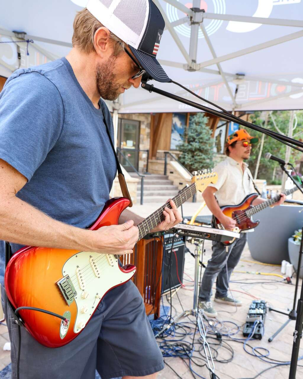 Andy Gunion, left, of the Snowmass-based band Nearly Now, performs in front of The Collective on Saturday, July 10, 2021, in Snowmass Base Village. Photo by Austin Colbert/The Aspen Times.