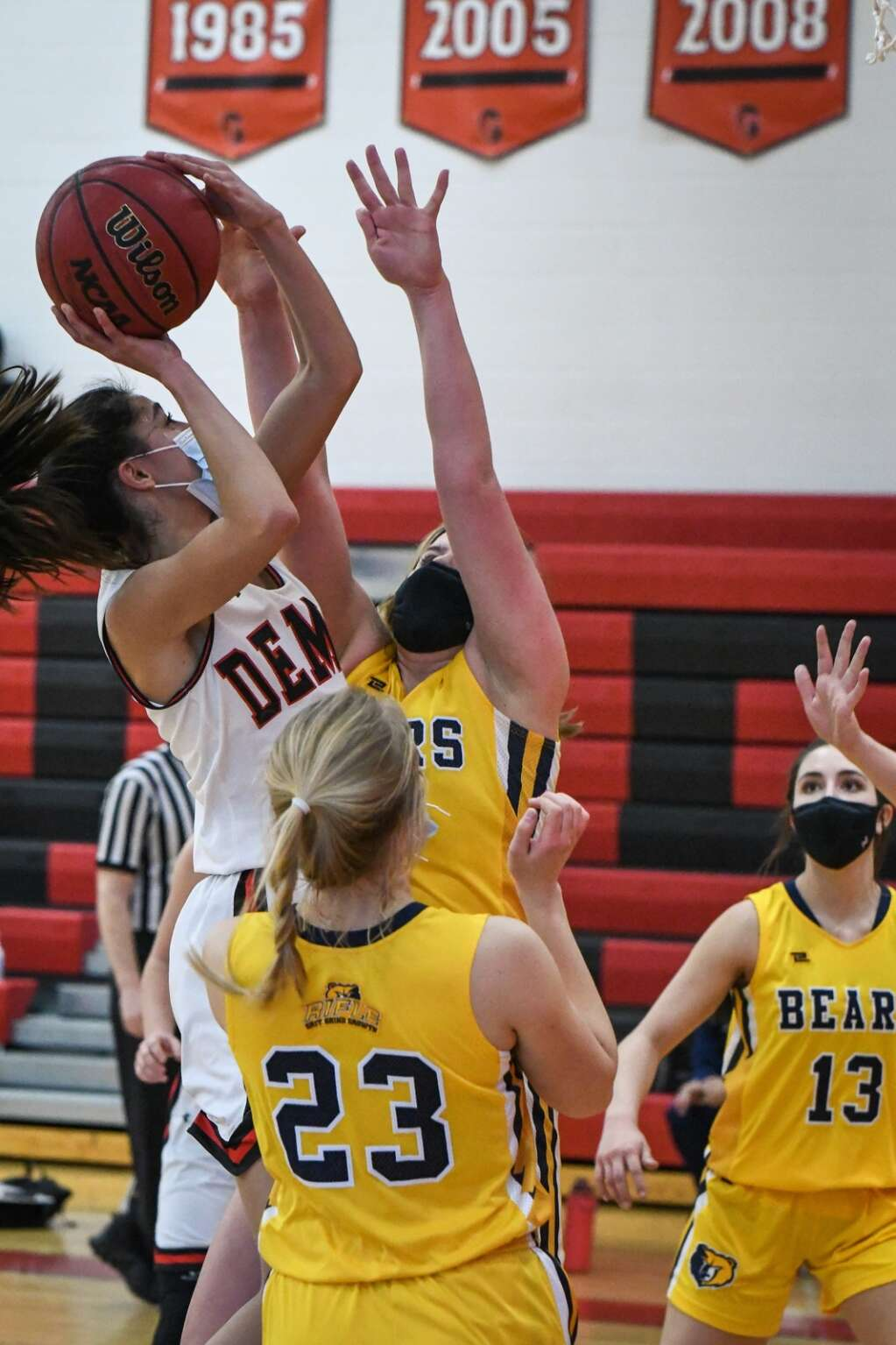 Glenwood Springs Demon Miah Suarez leaps through the defending Rifle Bears during Tuesday night's rivalry game at Glenwood Springs High School. |Chelsea Self / Post Independent