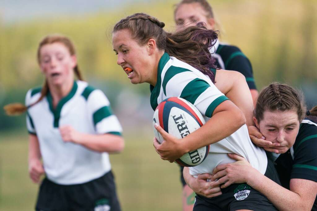 Sophomore Rose Rode tries to break free of a tackle from sophomore Regan Jackson during the Green-White rugby match held at Tiger Stadium in Breckenridge on Thursday, Sept. 2. | John Hanson/For the Summit Daily News