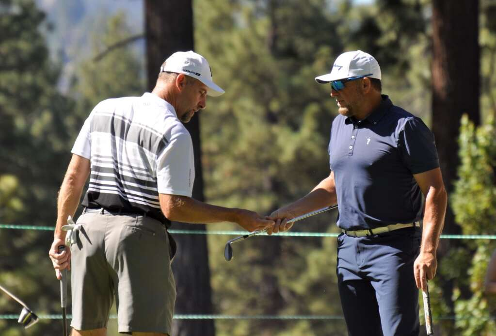 John Smoltz (left) and Kevin Millar played a practice round together on Thursday.
