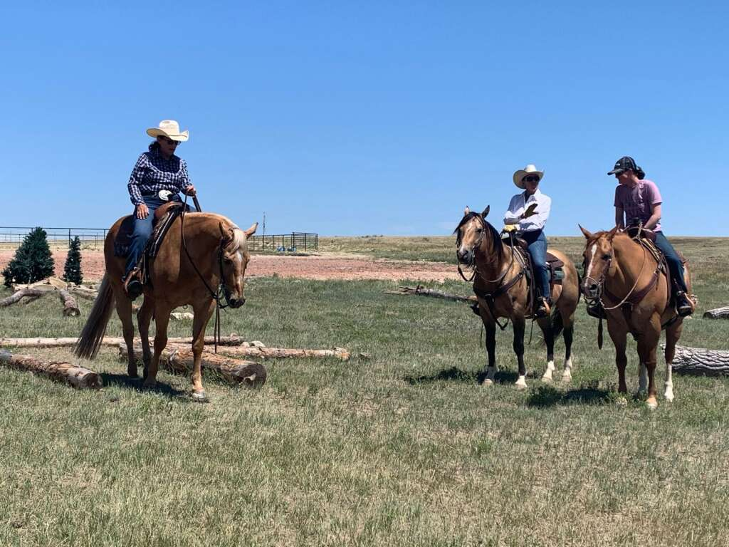 """Cowgirls on the outdoor trail challenge at the Kluz barn near Gillette, Wyo. The outdoor challenge is a """"grand time"""" for participants, Kluz said."""