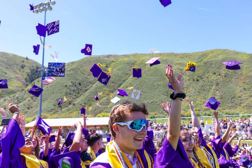 Students toss their caps into the air to conclude the Basalt High School graduation ceremony on Saturday, May 22, 2021, on the BHS football field. Photo by Austin Colbert/The Aspen Times.