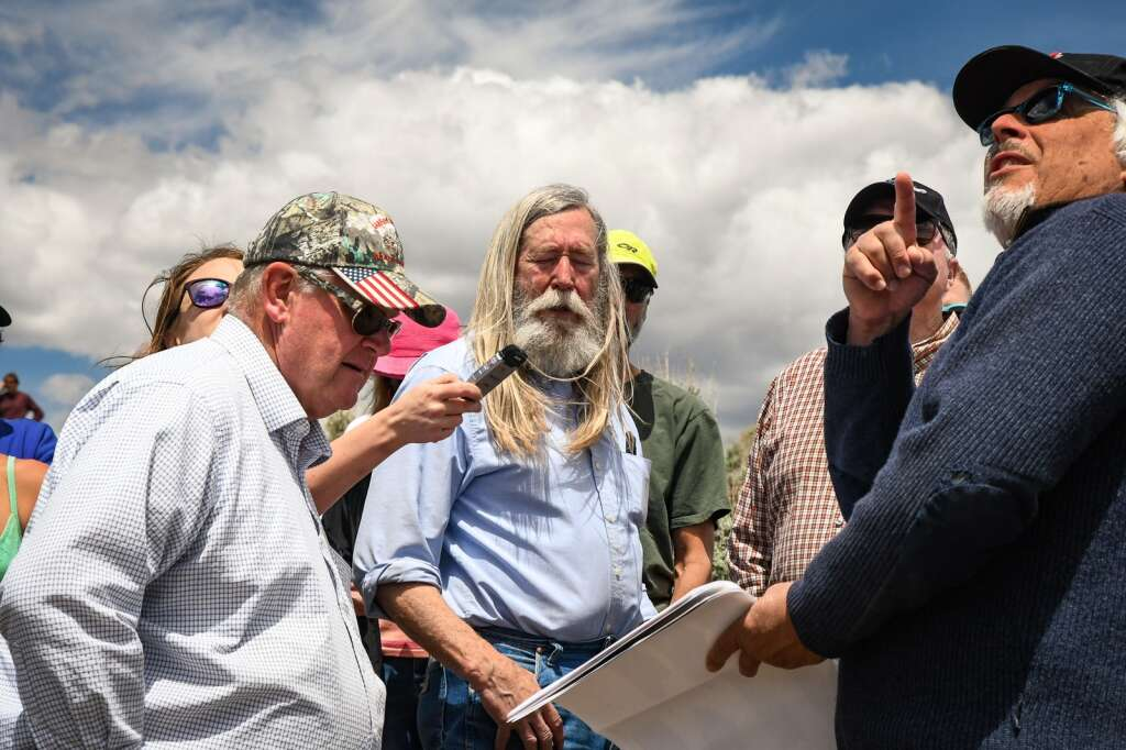 Garfield County Commissioners speak with land-use consultant Bob Schultz during the Ascendigo site visit on Tuesday afternoon. |Chelsea Self / Post Independent