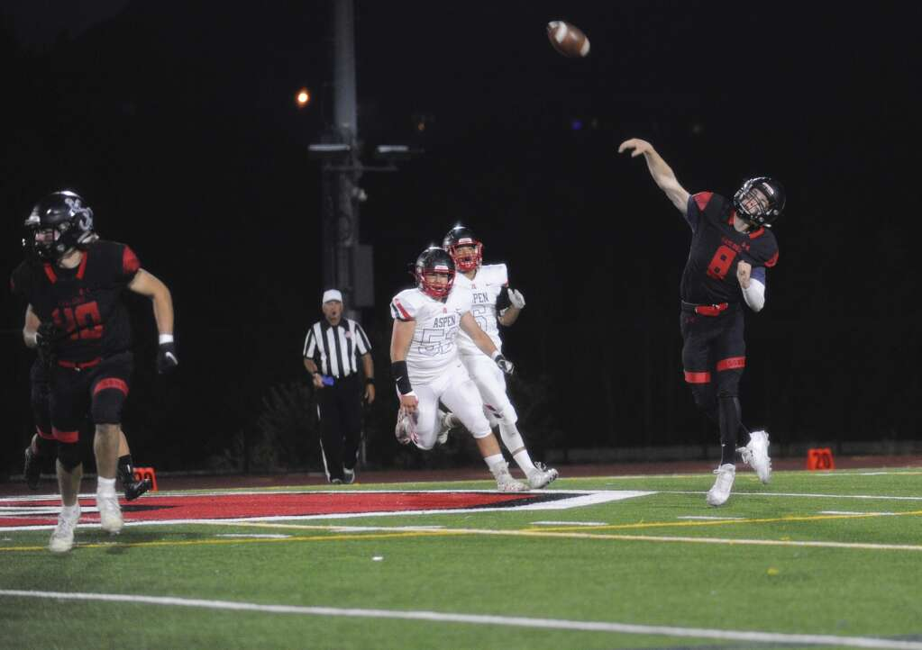 Steamboat Springs senior quarterback Jake Hamric makes a pass during the homecoming game against Aspen on Friday night. | Shelby Reardon/Steamboat Pilot & Today