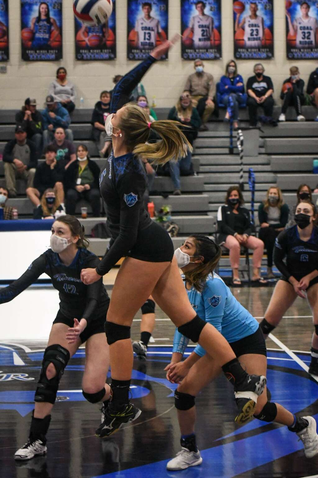 Coal Ridge Titan Brecken Guccini jumps up to spike the ball during Tuesday night's game against the Rifle Bears. |Chelsea Self / Post Independent