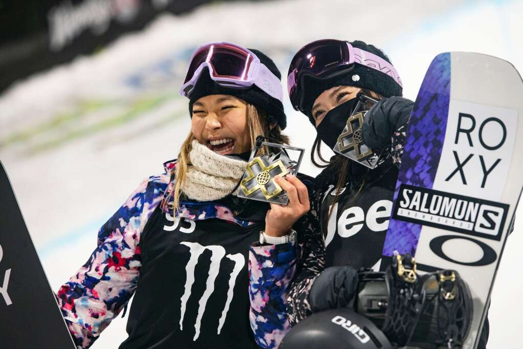Chloe Kim, left, and Haruna Matsumoto hold up their medals from the women's superpipe finals at the 2021 X Games Aspen at Buttermilk on Saturday, Jan. 30, 2021. (Kelsey Brunner/The Aspen Times)