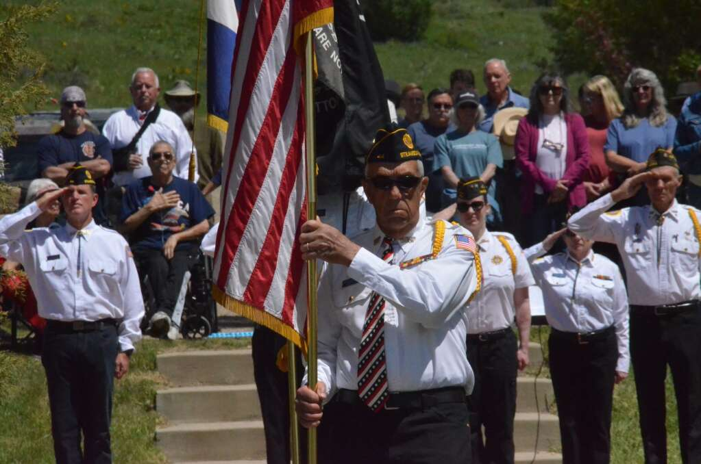 Veteran Doc Daugenbaugh carried the American Flag during a Memorial Day Ceremony at Steamboat Springs Cemetery. (Photo by Dylan Anderson)