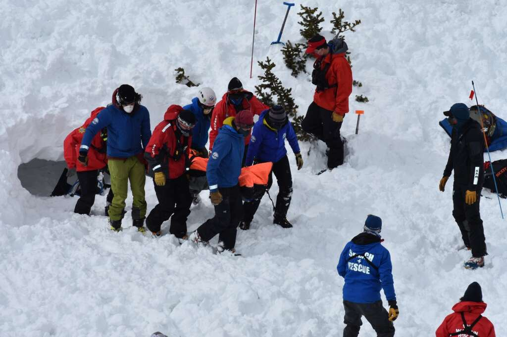 Rescue workers transfer the buried person to a snowmobile for evacuation. | Photo by Sawyer D'Argonne / sdargonne@summitdaily.com