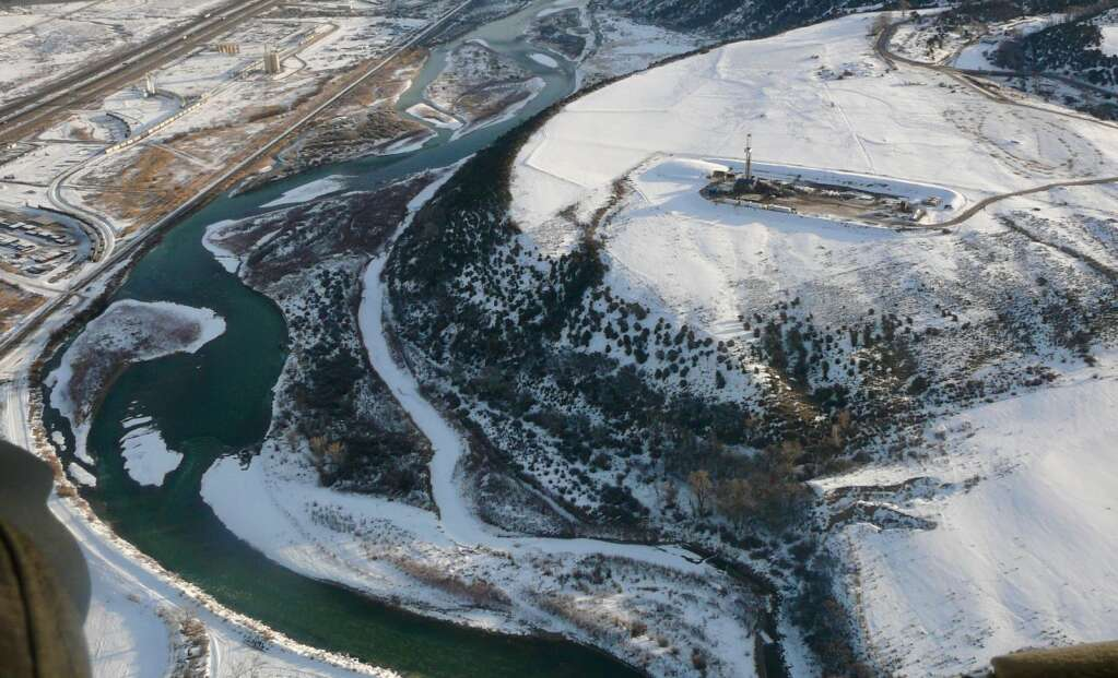 A natural gas well pad sticks out in a snowy landscape above the Colorado River during a previous winter. | Ecoflight/courtesy photo