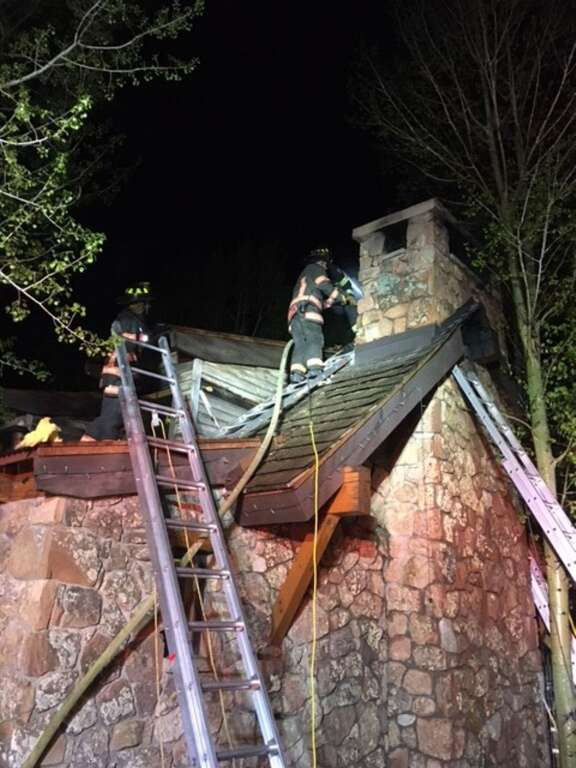 Firefighters check for hot spots on the roof of pavilion that ignited Wednesday night at a residence on Snowmass Creek Road. | Roaring Fork Fire Rescue/courtesy photo