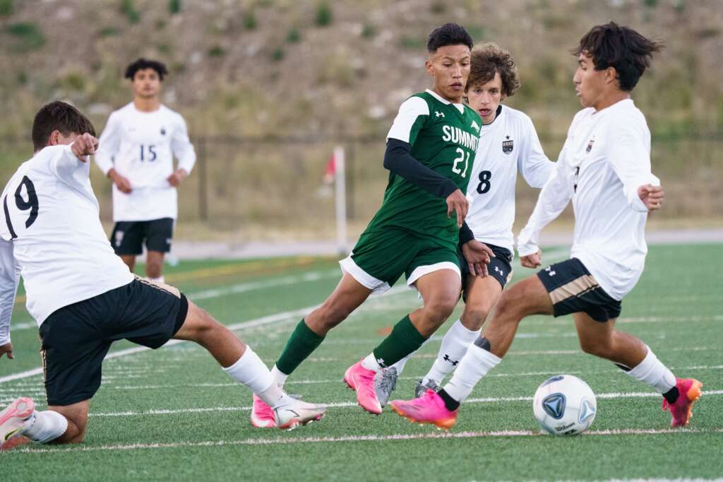 Fabian Cuevas flicks the ball between the legs of a charging defender as he makes a move toward the goal during the Summit Tigers homecoming match against Battle Mountain on Tuesday, Sept. 21, at Tiger Stadium in Breckenridge. | John Hanson/For the Summit Daily News