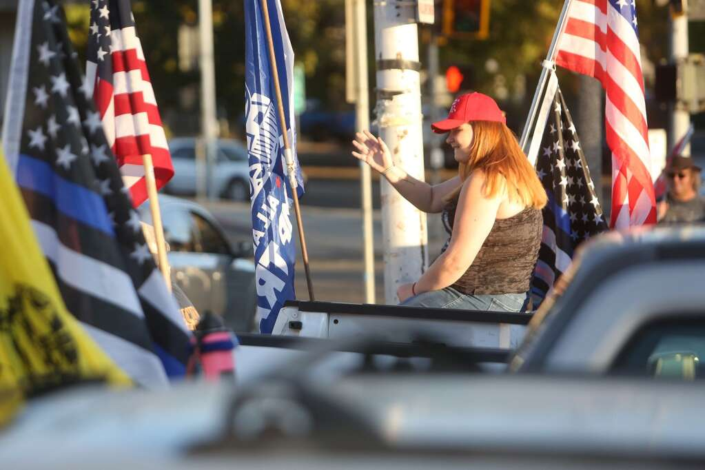 About a dozen Trump supporters gathered along the corner of Neal Street and South Auburn Streets Nov. 4  to hold a Trump 2020 post election rally for America. | Photo: Elias Funez