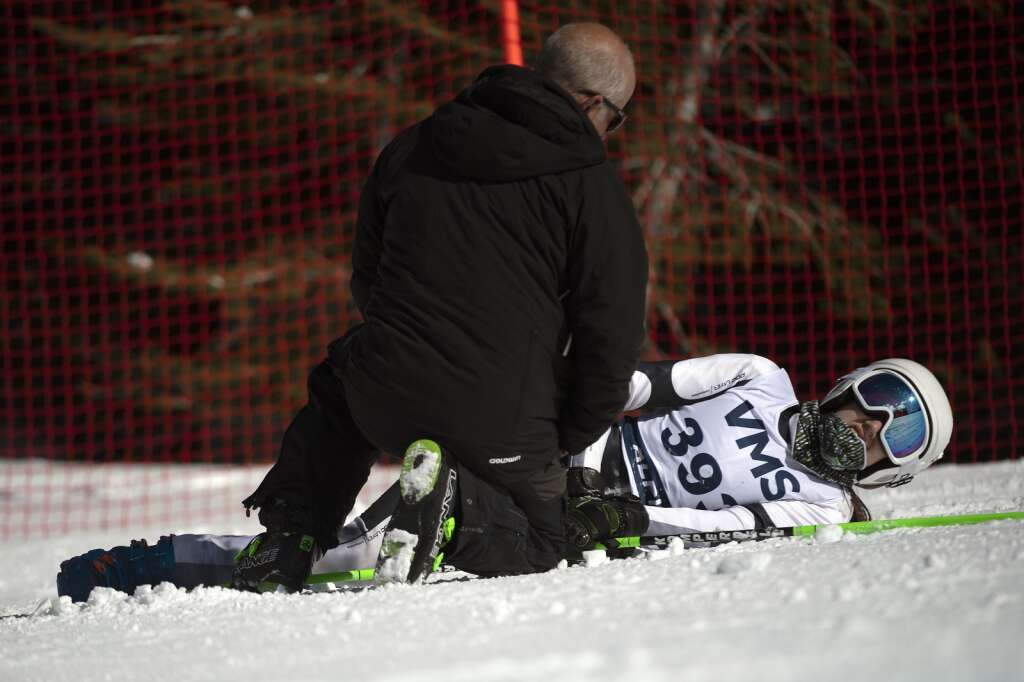 Vail Mountain School Alpine ski team racer Juliet Studness is checked on after a crash in the girls giant slalom race during the Colorado High School State Alpine Ski Championships at Loveland Ski Area on Friday, March 12, 2021.   Photo by Jason Connolly / Jason Connolly Photography