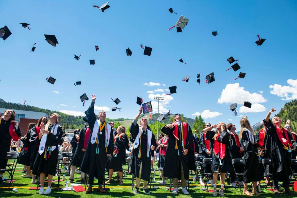 Aspen High School graduates toss their caps at the conclusion of the 2021 commencement ceremony on the school's turf football field on Saturday, June 5, 2021. (Kelsey Brunner/The Aspen Times)
