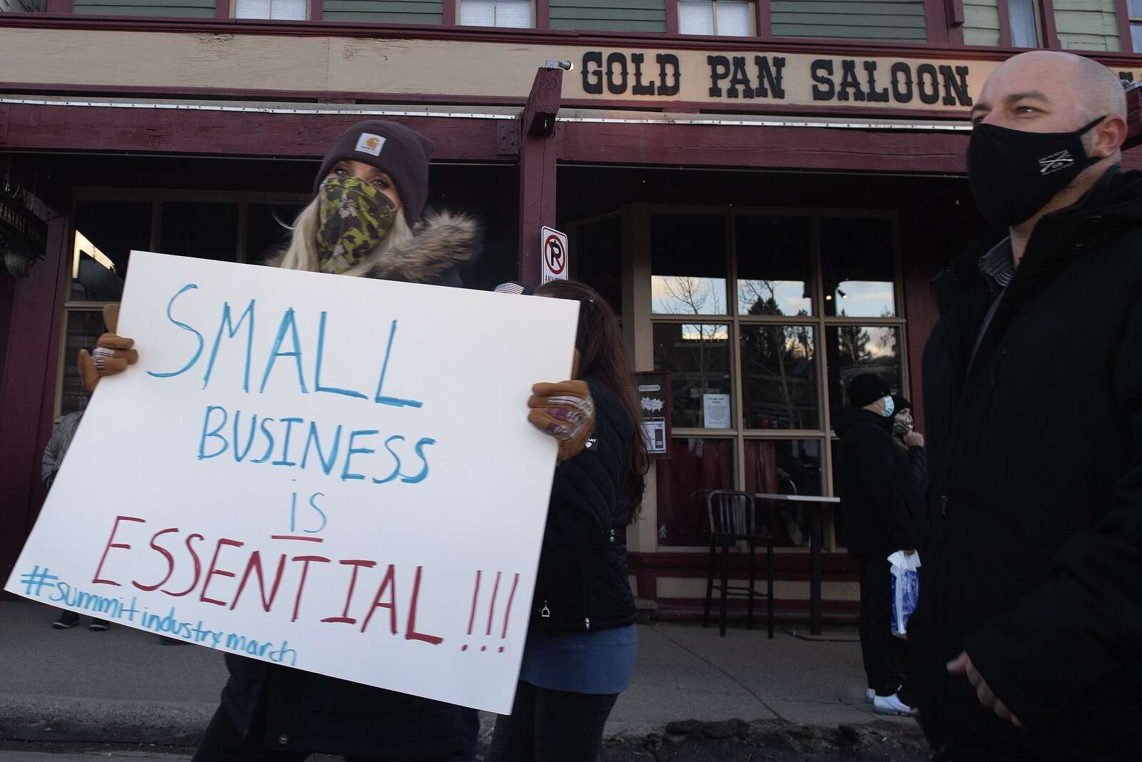 Summit County service industry workers march past the Gold Pan Saloon on Monday, Nov. 23, in Breckenridge while protesting the prohibition of in-person dining at restaurants.