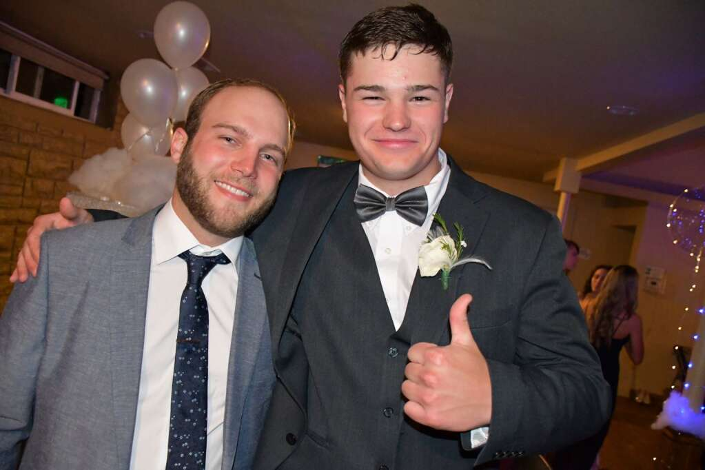 Jack Doane poses for a photo with Tyler Sieslove at prom Saturday. (Andy Bockelman / For Craig Press)