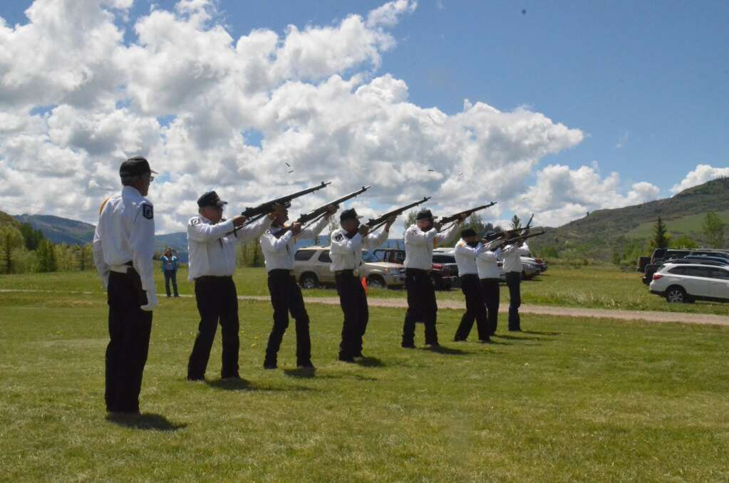 Members of the rifle squad shoot a series of three shots as part of a Memorial Day ceremony at Steamboat Springs Cemetery. (Photo by Dylan Anderson)