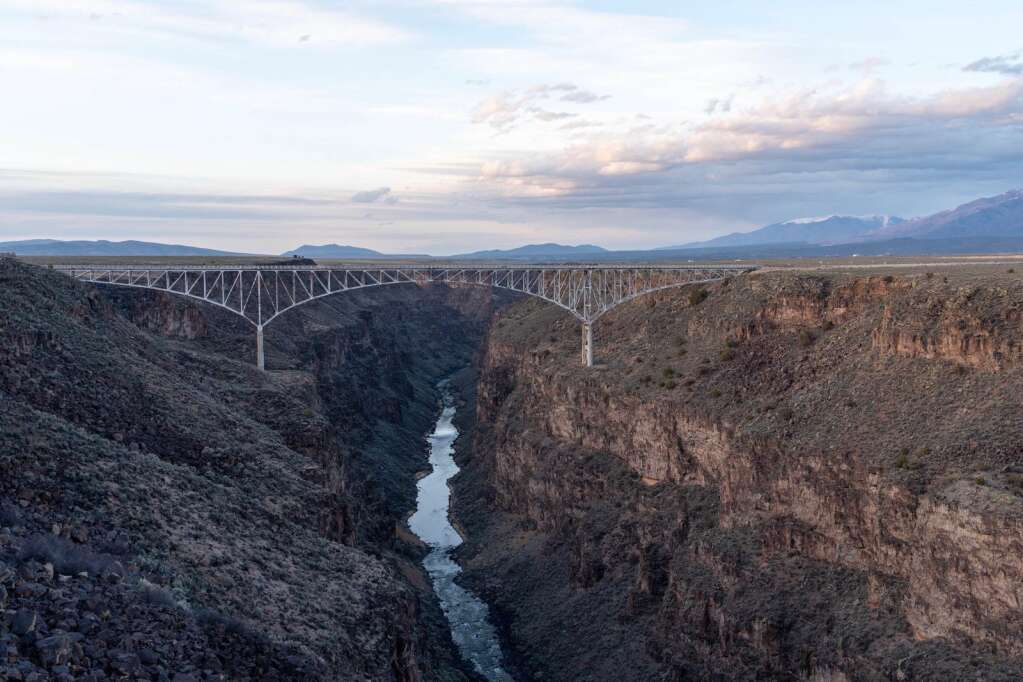You'll cross over the Rio Grande Gorge Bridge, which lies about 600 feet above the river, before arriving in downtown Taos. | Craig Turpin/Rising Sun Photog
