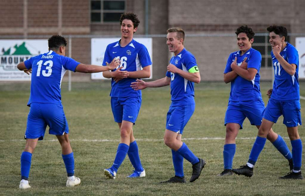The Coal Ridge Titans react after Moises  Contreras scores a goal in the second half during Thursday's playoff game against the Middle Park Panthers. |Chelsea Self / Post Independent