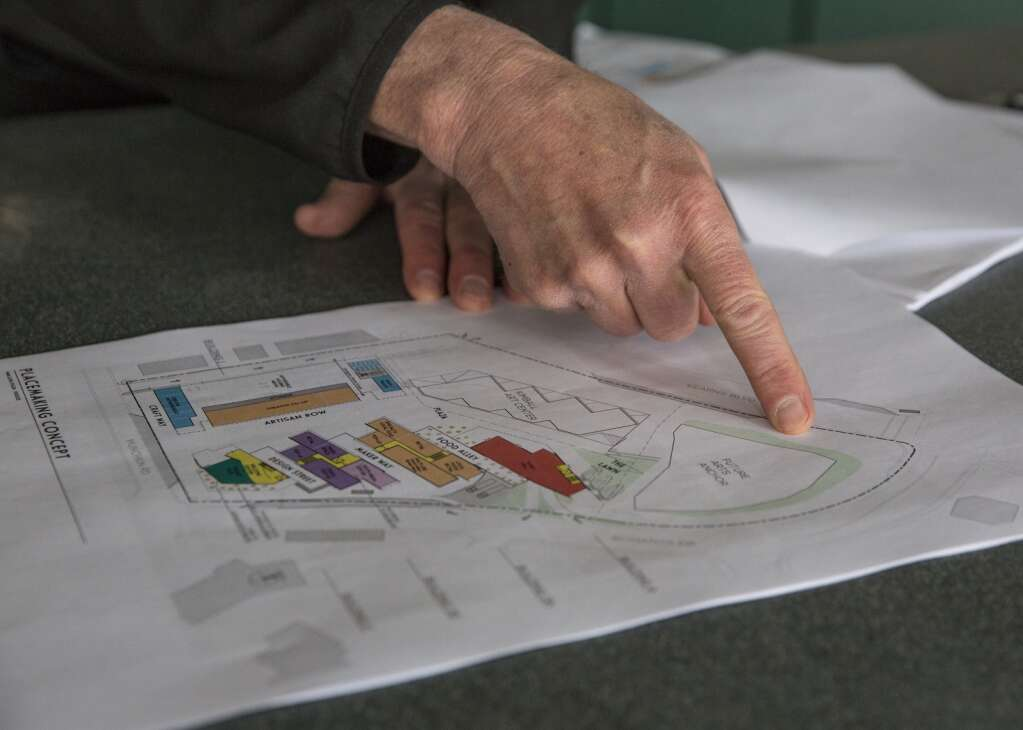 Steve Swisher, program manager with GTS development, points to various features on a proposed map of the Arts & Culture District development at the former Maverik gas station Monday afternoon, March 29, 2021. (Tanzi Propst/Park Record)