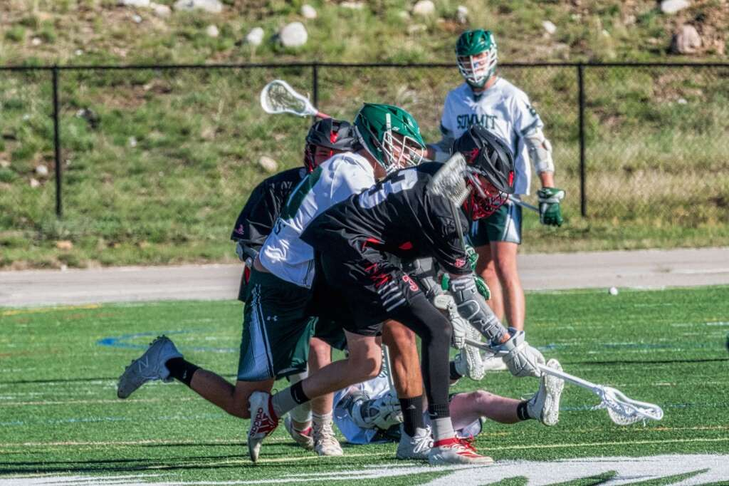 The Summit High School varsity boys lacrosse team battles versus Aspen during a 10-4 loss on Thursday, May 27, 2021 at Summit High School in Breckenridge. | Photo by Joel Wexler / Rocky Mountain.Photography