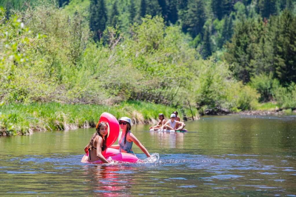 Friends Riley Rushing, 17, and Brooklyn Woods paddle their flamingo floaty to the North Star Nature Preserve takeout during at the end of an afternoon float on a hot day in Aspen on Monday, June 14, 2021. (Kelsey Brunner/The Aspen Times)