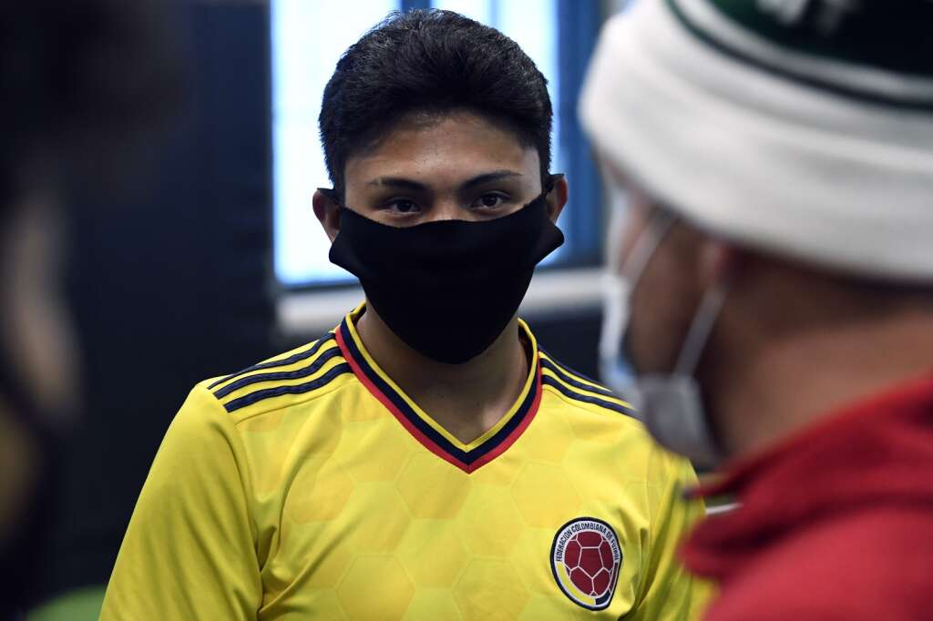Summit High School boys varsity soccer player Alan Casillas listens to head coach Tommy Gogolen during an indoor practice at Summit High on Tuesday, March 16. | Photo by Jason Connolly / Jason Connolly Photography