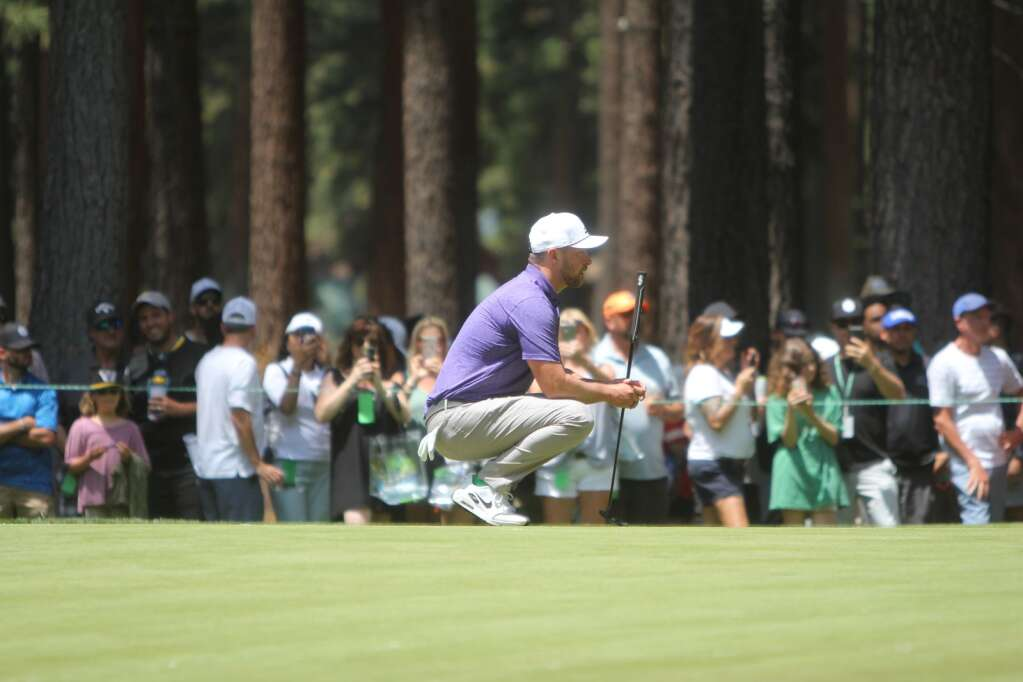 JT getting ready to putt.
