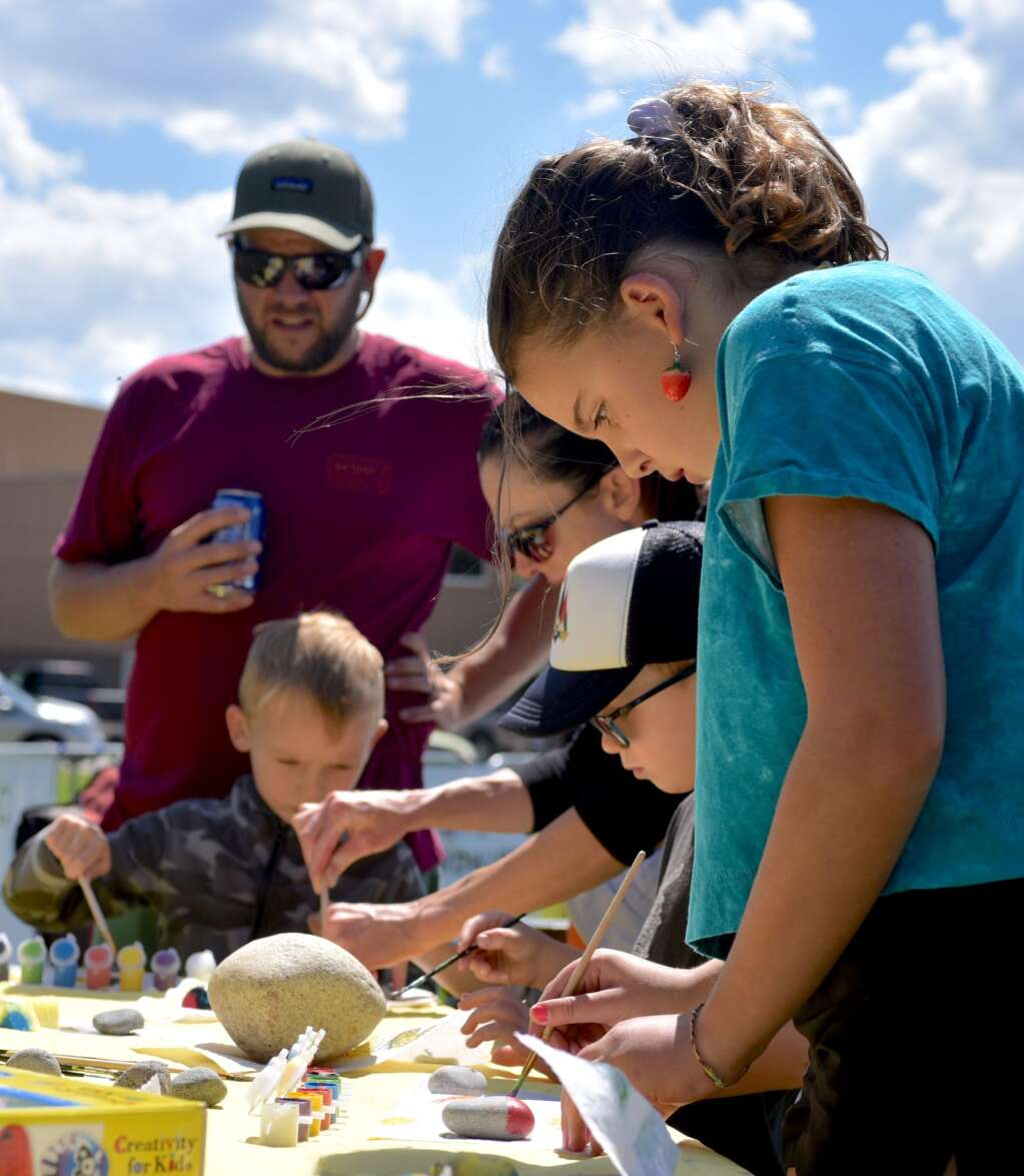 Siena Dimuro paints a rock as part of the kids activities at Art in the Park on Saturday, Sept. 3, 2021, at Polhamus Park in Granby.   Amy Golden/Sky-Hi News