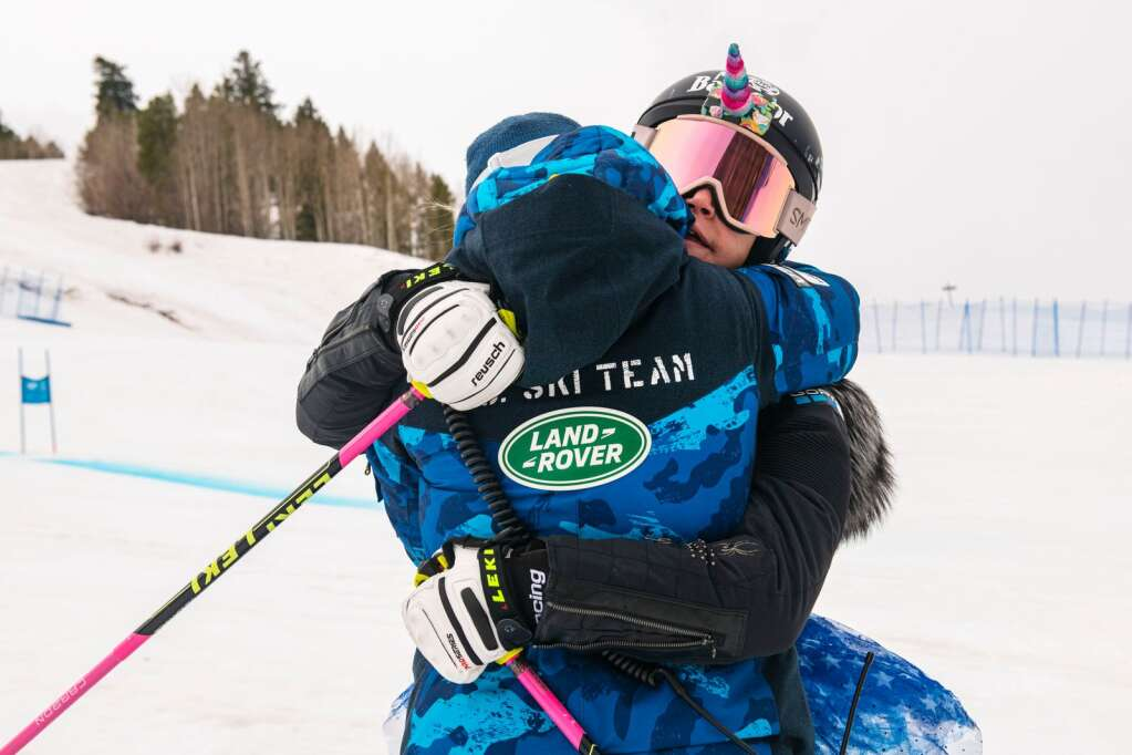 """American alpine skier Laurenne Ross hugs her coach Karin Harjo during Ross's final lap to celebrate her retirement during the National Championships at Aspen Highlands on Tuesday, April 13, 2021. """"I was a fan before I got to coach them,"""" said Ross about the women's World Cup speed team. """"They're amazing."""" (Kelsey Brunner/The Aspen Times)"""