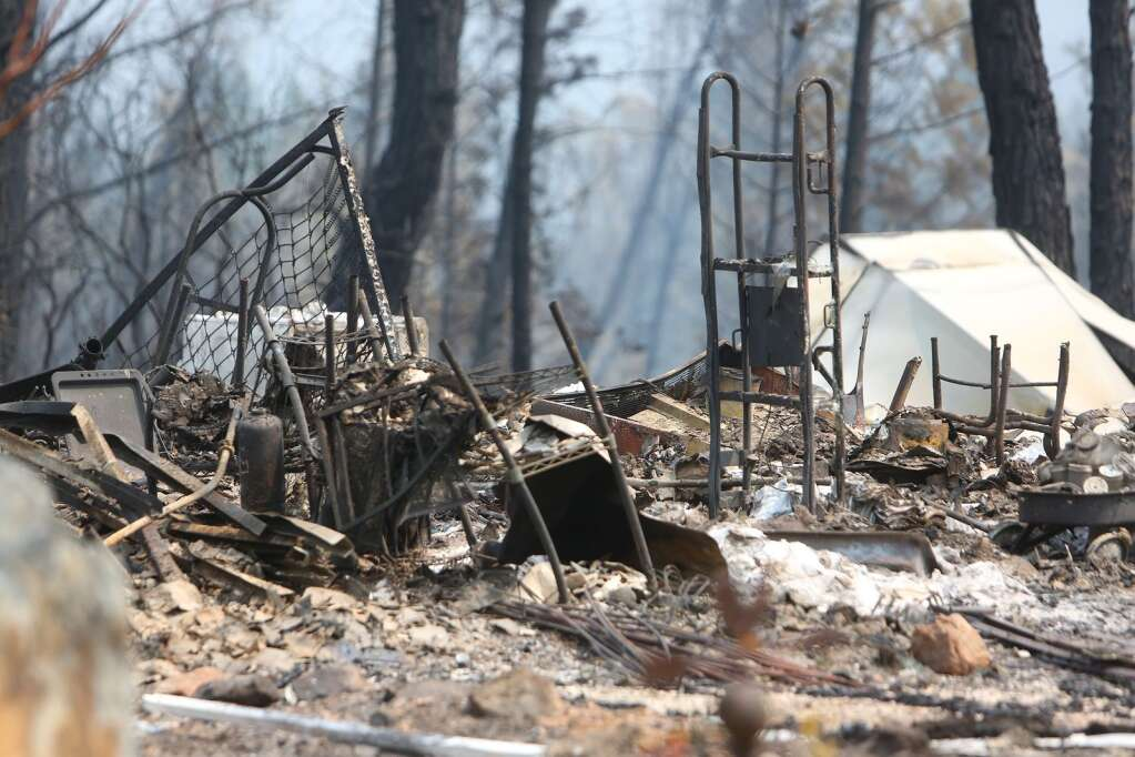 Only charred metal and ash remain where the Cooke's home once sat in the Newtown community of Nevada County after the Jones Fire burned through in August. | Photo: Elias Funez