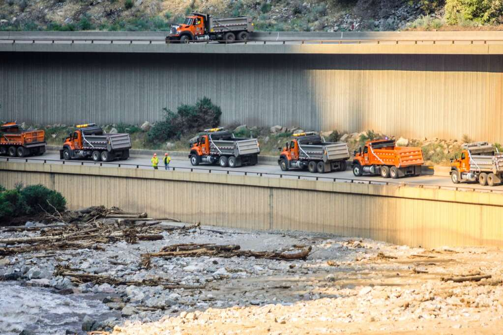 Colorado Department of Transportation trucks wait to be filled up with rock and mud Wednesday in Glenwood Canyon.