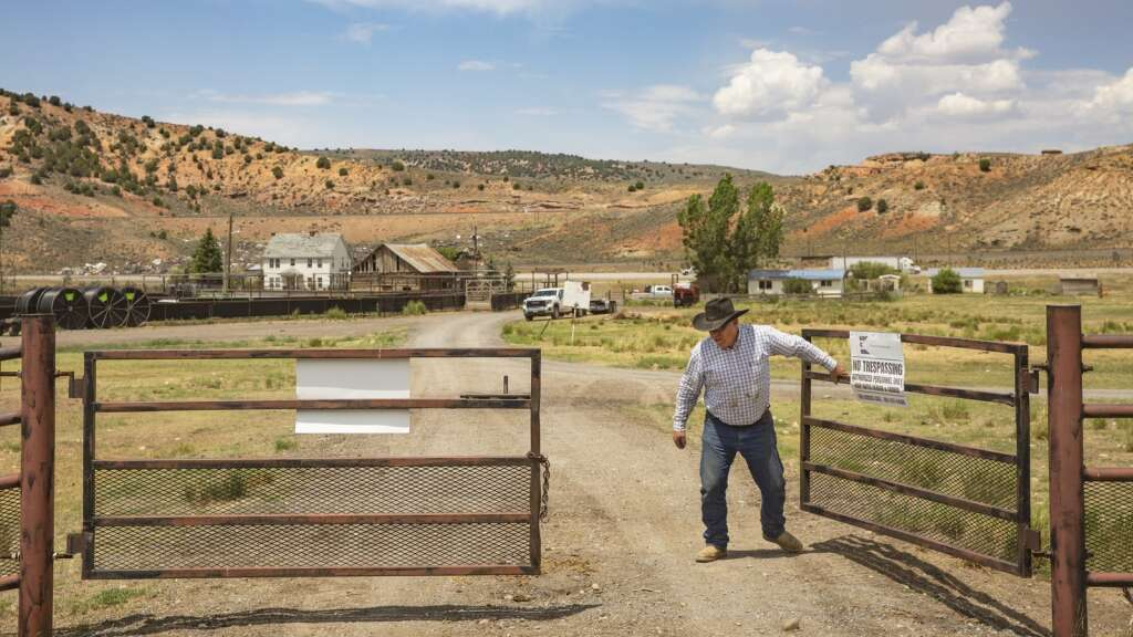 Jeff Young, general manager of Ensign Ranches, closes a wrought iron gate as he heads out onto the Ensign Ranch property Wednesday afternoon, July 7, 2021. (Tanzi Propst/Park Record)