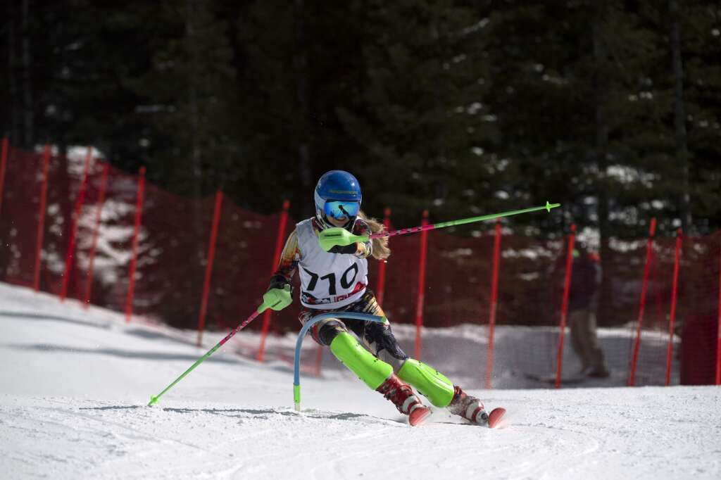 Evergreen High School Alpine ski team racer Chloe Baughn navigates gates while skiing the slalom course during the Colorado High School State Alpine Ski Championships at Loveland Ski Area on Friday, March 12, 2021.   Photo by Jason Connolly / Jason Connolly Photography