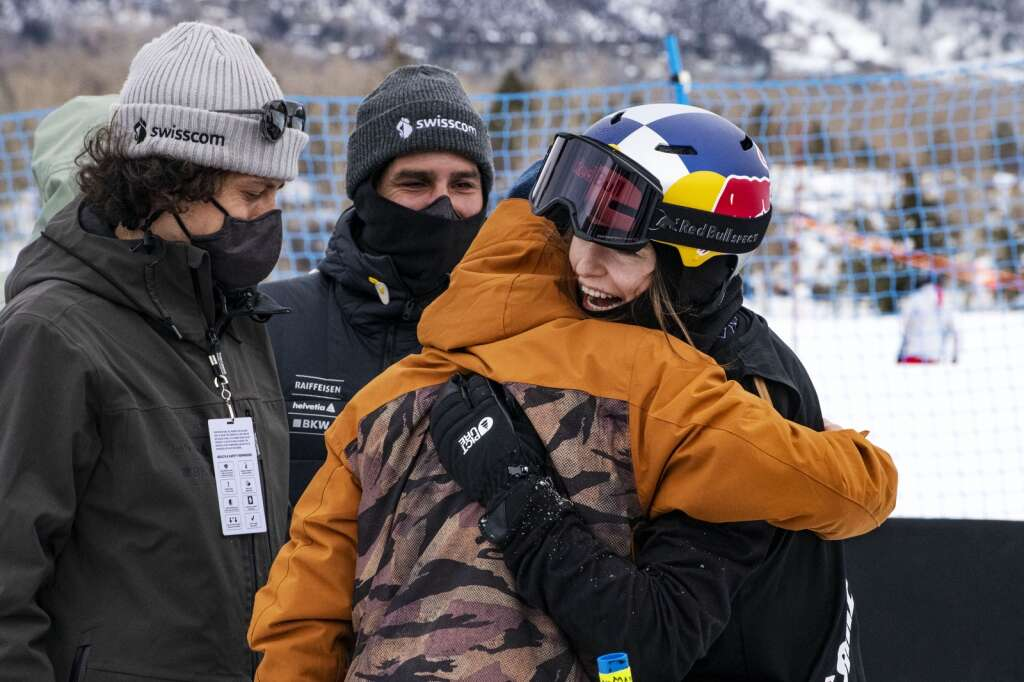 Swiss freestyle skier Mathilde Gremaud hugs her teammate Fabian Boesch after successfully completing a switch double cork 1440 during the Big Air competition that won her the gold medal at the 2021 X Games Aspen at Buttermilk on Friday, Jan. 29, 2021. Gremaud landed the first switch double cork 1440 in history during a womens big air competition. (Kelsey Brunner/The Aspen Times)