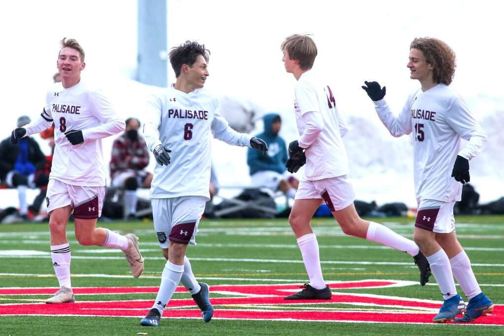 Palisade players celebrate a goal against Aspen High School on Thursday, March 25, 2021, on the AHS turf. Photo by Austin Colbert/The Aspen Times.