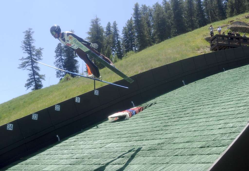 Taylor Fletcher, a native of Steamboat Springs and a two-time Olympian, soars through the air during the Jumpin 'and Jammin' event at Howelsen Hill on Sunday, July 4th.  (Photo by Shelby Reardon)