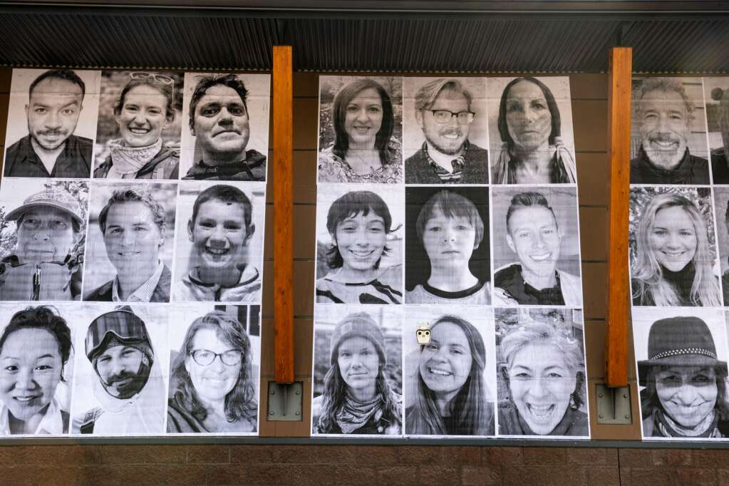 """Self-portraits hang on the side of the Colorado Mountain College campus for the """"Stories of Climate Change/Historias del Cambio Climatico"""" mural project in Aspen on Monday, Feb. 22, 2021. (Kelsey Brunner/The Aspen Times)"""
