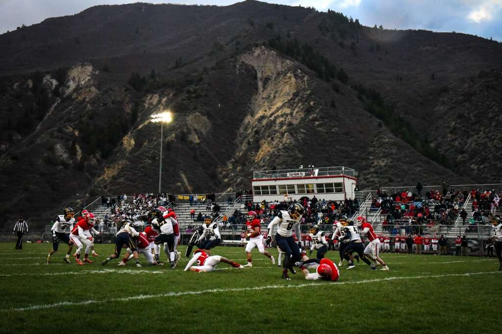 The Rifle Bears and the Glenwood Demons battle on the gridiron during the rivalry game at Stubler Memorial Field in April. The Demons defeated the bears 22-15, the first win over Rifle since 2010. |Chelsea Self / Post Independent