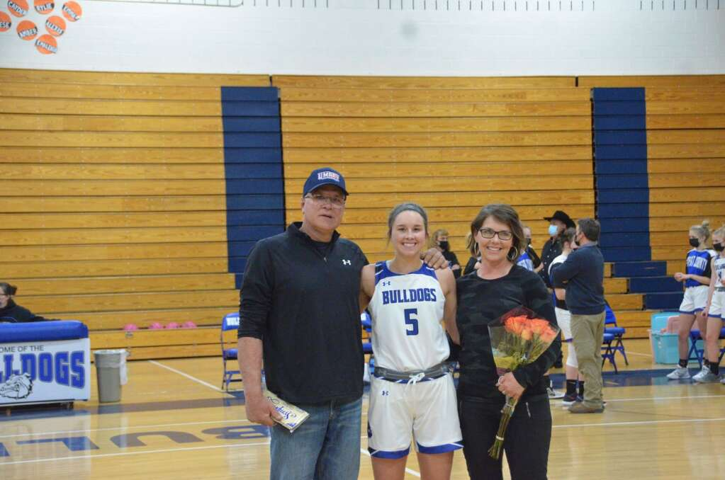 Senior Emaleigh Papierski stands with her parents during the Senior Night celebration at Moffat County High School Thursday. (Max O'Neill / Craig Press)