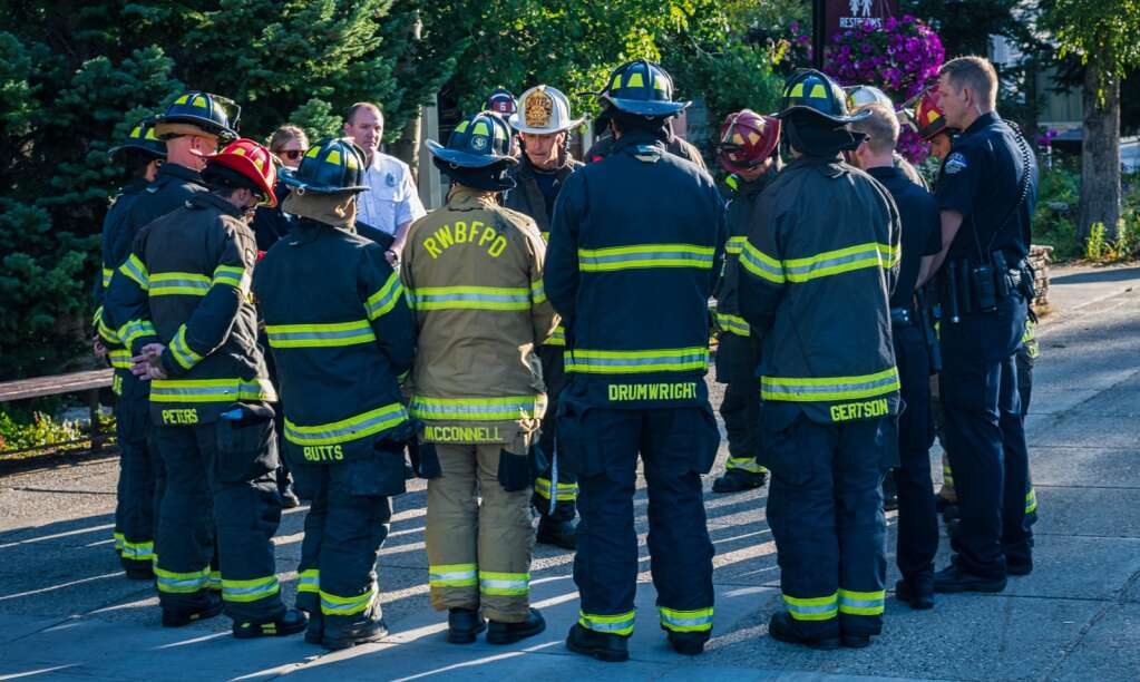 Firefighters from the Red, White & Blue Fire Protection District, as well as officers from the Breckenridge Police Department, gather in a circle on the Blue River Plaza on Sept. 11, 2021. The organizations hosted a small, brief ceremony to honor the 20th anniversary of 9/11.   Joel Wexler/For the Summit Daily News