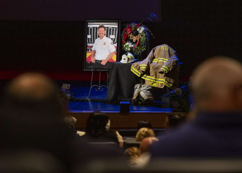 A tribute to Park City Fire Chief Paul Hewitt is displayed on stage at the Eccles Center during a memorial service Thursday evening. | (Tanzi Propst/Park Record)