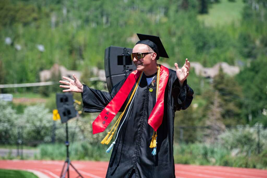 Aspen High School's valedictorian Alex Appleby dances in front of his classmates to applause as he takes the stage for his speech during the commencement ceremony on Saturday, June 5, 2021. (Kelsey Brunner/The Aspen Times)