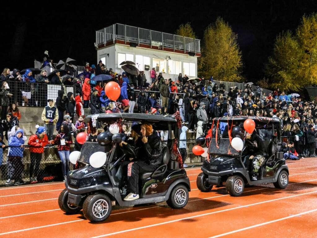 Members of the Aspen High School homecoming court drive in front of the fans during halftime of the football game between Aspen and Delta on Friday, Oct. 8, 2021, on the AHS turf. Photo by Austin Colbert/The Aspen Times.
