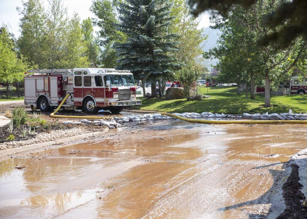 A water line break near Snow Creek Drive sent water flowing into the parking lots of the nearby business strip Tuesday afternoon, Sept. 6, 2021. (Tanzi Propst/Park Record)