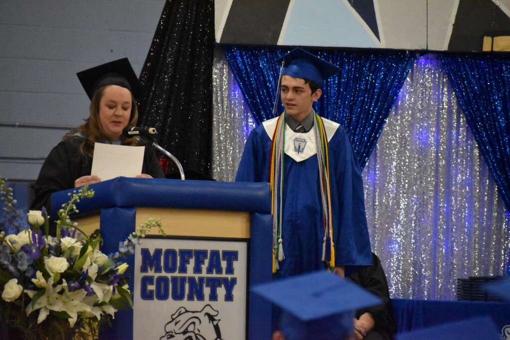 Jacob Jeffcoat listens to Krista Schenck name him the Outstanding Male Senior in the Class of 2021. (Joshua Carney / Craig Press)