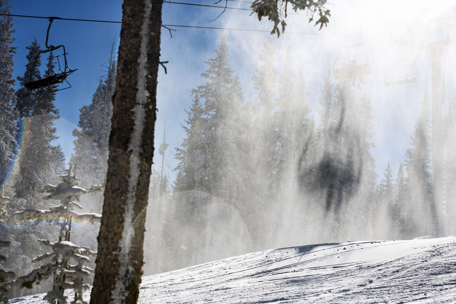 Skiers ride the Gents Ridge Lift while Aspen Skiing Company continues to make snow on opening day on Aspen Mountain on Wednesday, Nov. 25, 2020. (Kelsey Brunner/The Aspen Times)